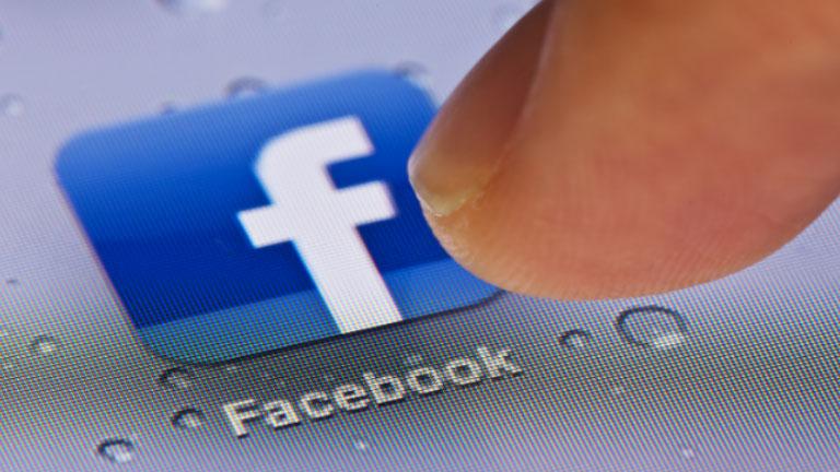 Facebook logo with finger